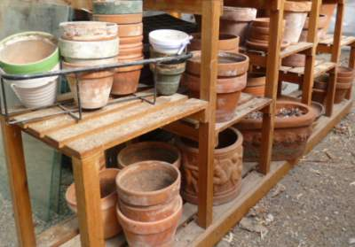 A collection of many different sized terracotta pots