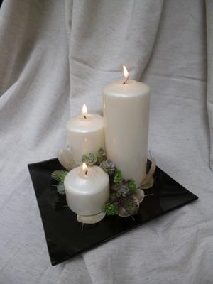 White candles with Sedum
