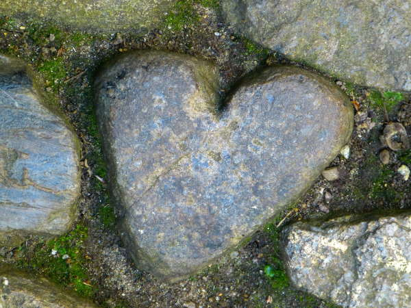 A stone heart in a pathway