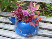 Succulent Flower Arrangement in a blue kettle