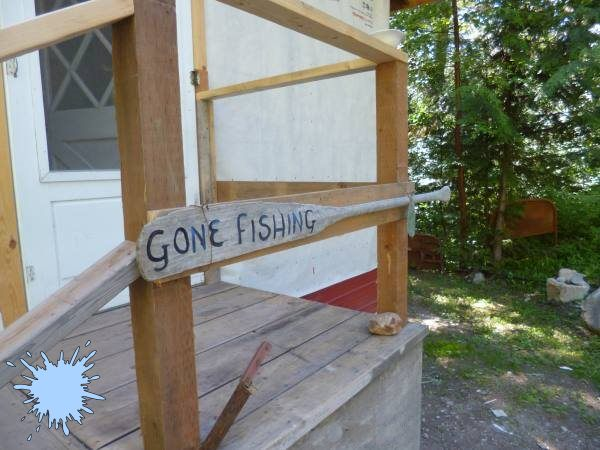 Gone Fishing Sign painted on an old oar
